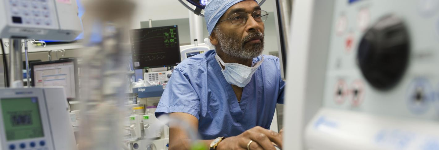 Emery Brown in an operating room setting wearing scrubs