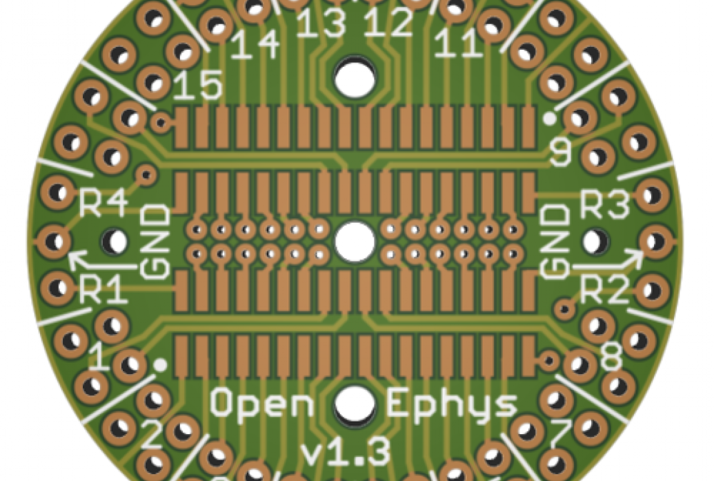 A round circuit board labeled Open Ephys
