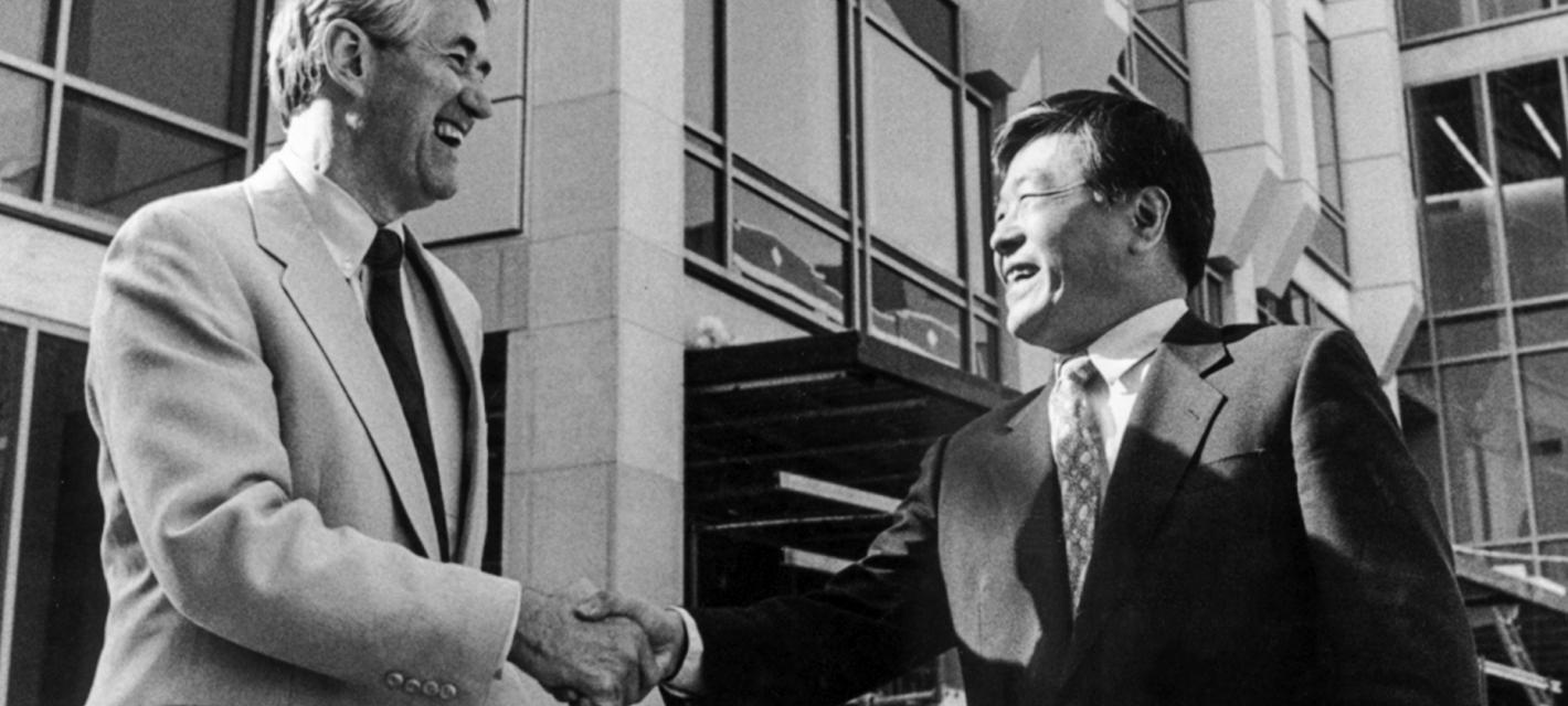 Susumi Tonegawa shaking hands with Dean Robert Birgeneau