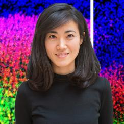 A portrait of Gloria Choi is superposed over brightly stained images of mouse cortex
