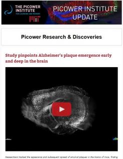 E-news screenshot features video of a brain labeled to show amyloid proteins